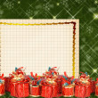 Christmas greeting card with presents on the  green abstract background — Stock Photo