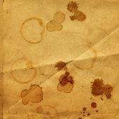 Old crumpled paper with stains of coffee or tea — Stok fotoğraf