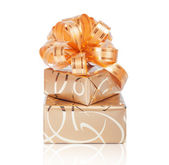 Beautiful Gift box in gold wrapping paper — Stock Photo