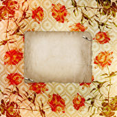 Alienated gold paper background for announcement with rose — Stock Photo