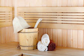 Traditional wooden sauna for relaxation with bucket of water — Stock Photo