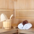 Traditional wooden sauna for relaxation with bucket of water and — Stock Photo #42280119