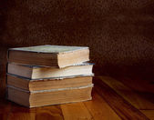 Pile of old books on a beautiful wooden table — Stock Photo