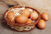 Fresh chicken eggs in straw nest — Stock Photo