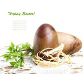 Decorative wooden Easter eggs with green branch on a beautiful l — Stock Photo
