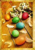 Grunge old carved postcard with eggs to celebrate Easter on the — Stock Photo