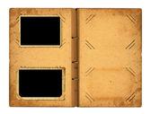 Open photoalbum with ribbon for photos — Stock Photo