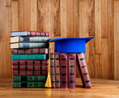 Mortarboard on  stack of books — Stock Photo