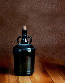 Old dusty bottle on a wooden table vintage — 图库照片