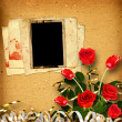 Old album with a bouquet of red roses — Stock Photo