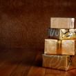 Gift box in gold wrapping paper — Stock Photo #46907751