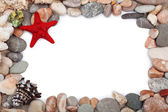 Red starfish and multicoloured pebbles — Stock Photo