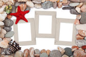 Paper Vintage photo frames with red starfish and pebbles — Stock Photo