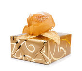 Beautiful gift box in gold paper with a silk rose — Stock Photo