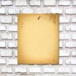 Old paper ad on shabby brick wall — Stock Photo #49165829
