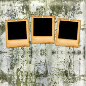 Old paper slides on the shabby brick wall — Stock Photo
