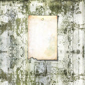 Old paper ad on shabby brick wall — Stock Photo