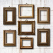 Gilded wooden frames on old stone wall — Stock Photo #49200137