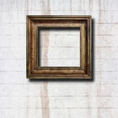 Gilded wooden frames on old stone wall — Stock Photo