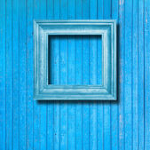 Vintage frame for picture on blue wooden wall — Стоковое фото