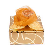 Beautiful gift box in gold paper with a silk rose isolated on a  — Stock Photo