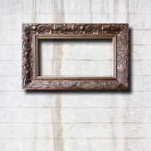 Gilded wooden frames for pictures on old stone wall — Stok fotoğraf