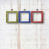 Multicolored  wooden frames on stone wall — Stock Photo