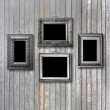 Vintage silver frame for picture on grey wooden wall — Stock Photo #49365145