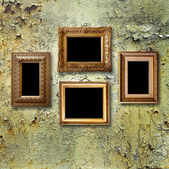 Gilded wooden frames for pictures on old  rusty metallic wall — Stok fotoğraf