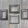 Vintage silver frame for picture on grey wooden wall — Stock Photo #49521611