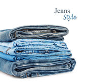 Stack of jeans trousers isolated on white background — Stok fotoğraf
