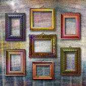 Gilded wooden frames for pictures on blue jeans background — Foto de Stock