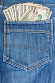 A hundred dollar bills sticking in the back pocket of denim blue — Stock Photo