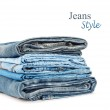 Stack of jeans trousers isolated on white background — Stock Photo #49838287