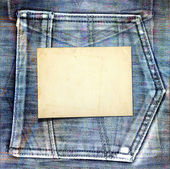 Old vintage frame on shabby jeans background — Stock Photo