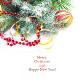Christmas tree branch with gold serpentine and red sphere on whi — Foto Stock