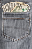 A hundred dollar bills sticking in the back pocket of denim blac — Stock Photo