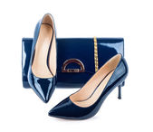 Bonitos sapatos azuis com embreagens em fundo branco isolado — Fotografia Stock