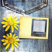 Old vintage postcard with beautiful yellow flowers on blue jeans — Stock Photo