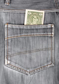 One dollar bill sticking in the back pocket of denim  black jean — Stock Photo