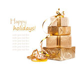 Gift boxes in gold wrapping paper — Stok fotoğraf
