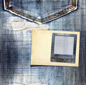 Vintage postcard with paper slides on old jeans background — Stock Photo