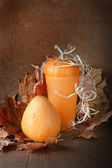 Pile of pumpkins with autumn foliage on abstract background — Φωτογραφία Αρχείου