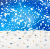 Christmas snowy background with blue stars and beads — Stock Photo