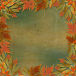 Bright autumn leaves on the abstract with paper frame — Stock Photo #7423457