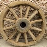 Wooden cart wheel — Stock Photo