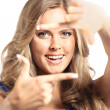 Young woman frame her face with hands — Stock Photo #12376167