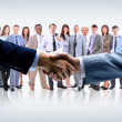 Handshake isolated on business background — Stock Photo #12489130