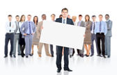 Business man with a banner and his business team — Stock Photo