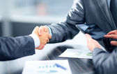 Business shaking hands in office — Stok fotoğraf
